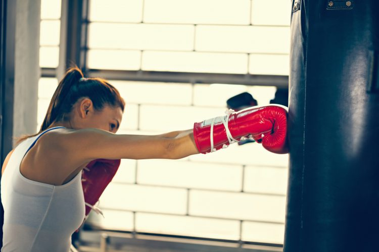 Woman Hitting a Punching Bag