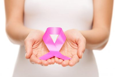 Breast Cancer Symbol in Hands