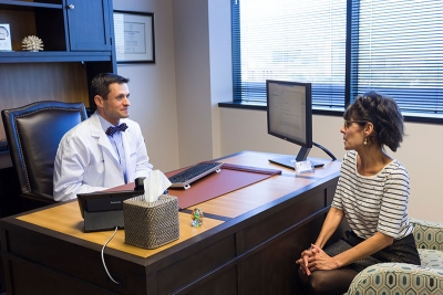 CCRM Houston doctor talking with a patient