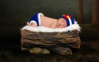 Newborn Baby Sleeping on a Piece of Wood