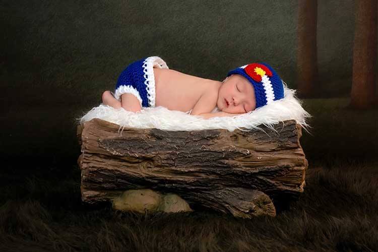 Newborn Baby Sleeping on a Piece of Wood
