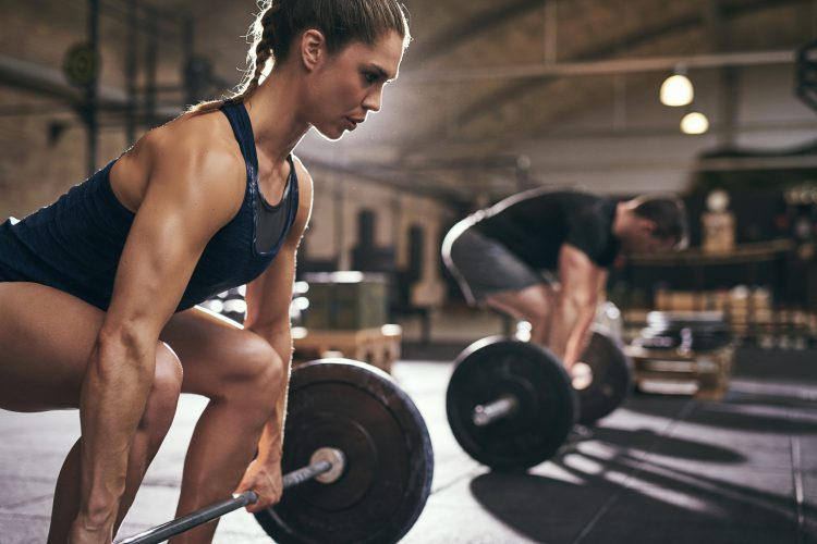 Woman in Gym Lifting Weights