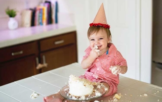 Baby Eating Birthday Cake on Counter