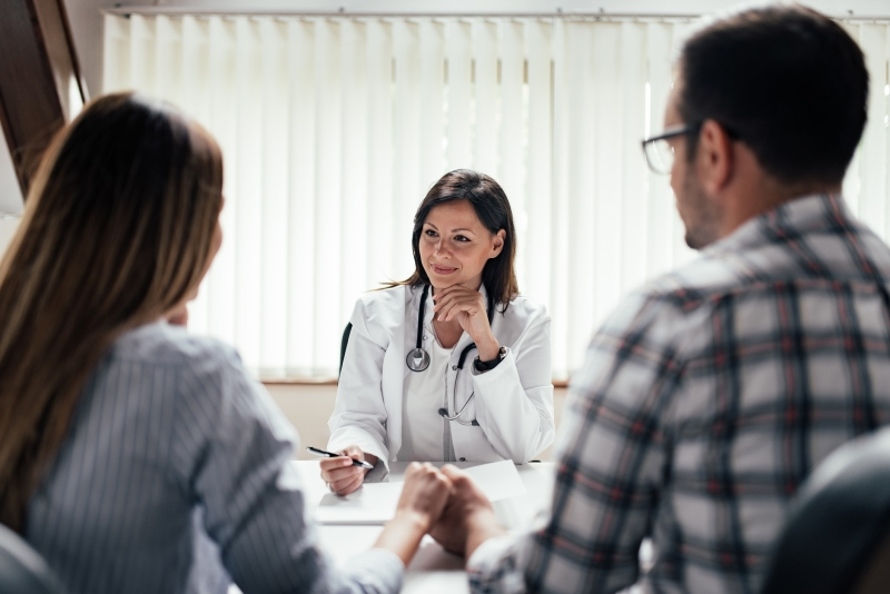 Young couple talking to a doctor