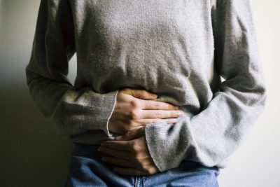 Woman in pain grabbing stomach