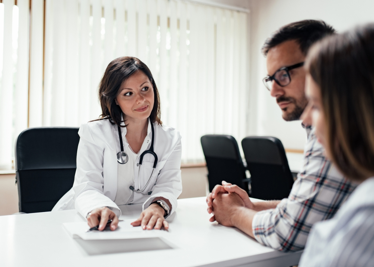 Doctor explaining results to a couple.