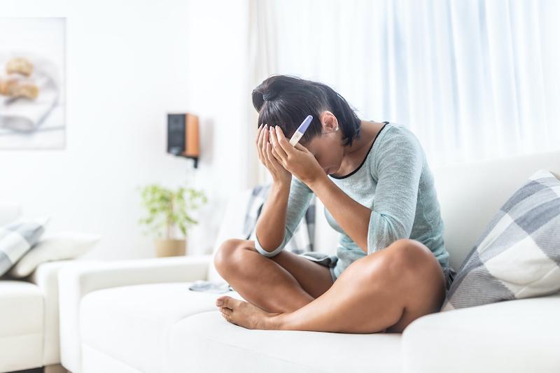 Woman sad with negative pregnancy test